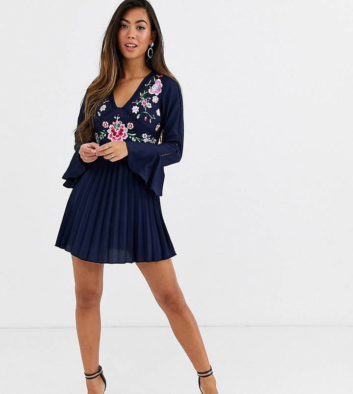 ASOS DESIGN Petite embroidered pleated mini dress with lace inserts in navy
