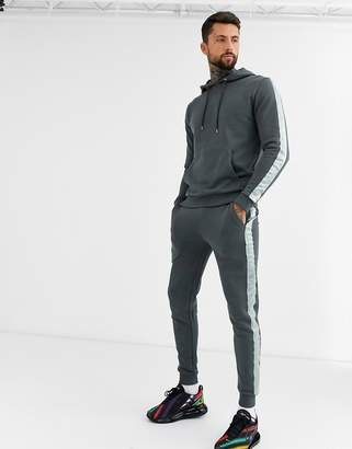 Asos Design DESIGN tracksuit hoodie/skinny joggers with satin side stripe in washed black