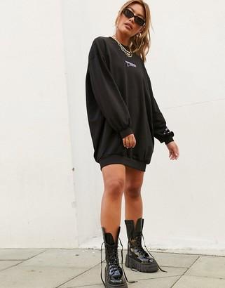 ASOS Weekend Collective mini sweatshirt dress in black with purple print