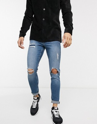 New Look rip and repair skinny jeans in light wash