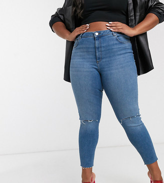 Asos DESIGN Curve Ridley high waisted skinny jeans in mid wash blue with rips
