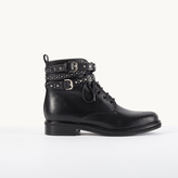 Maje Leather ankle boots with studded straps