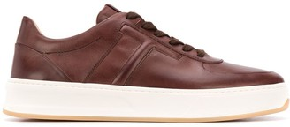 Tod's embossed T motif lace-up trainers