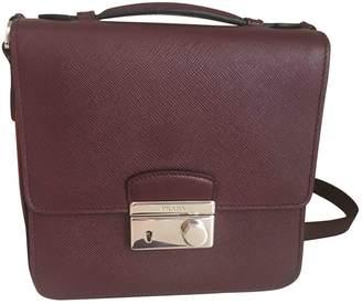 Prada saffiano Burgundy Leather Handbags
