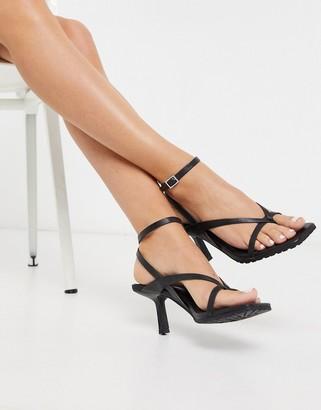 Asos DESIGN Humbug flip flop mid-heeled sandals in black