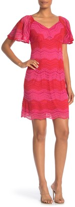 trina Trina Turk Exclusive Flutter Sleeve Lace Sheath Dress