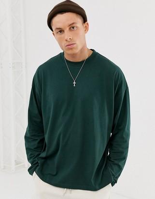 Asos DESIGN oversized longline long sleeve t-shirt with side splits in green