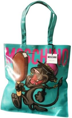 Moschino Blue Synthetic Handbags