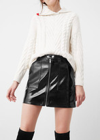 Mango Outlet Zipped patent skirt