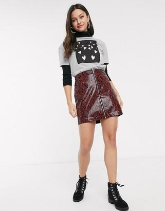 New Look vinyl snake zip mini skirt in red pattern