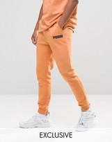 Puma Skinny Lounge Joggers In Orange Exclusive To Asos