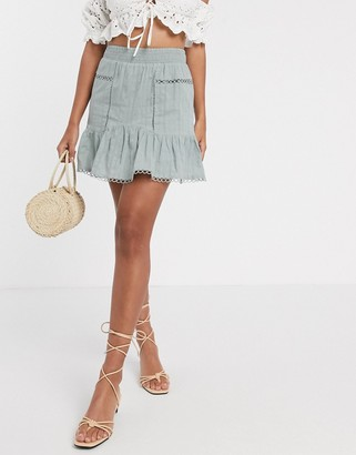 Asos DESIGN textured dobby mini skirt with ruffle and lace insert in pale green