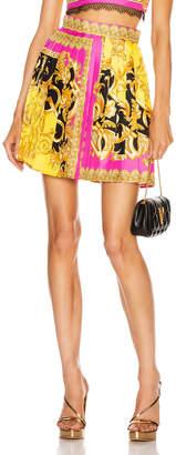 Versace Baroque Pleated Mini Skirt in Fuchsia & Yellow | FWRD