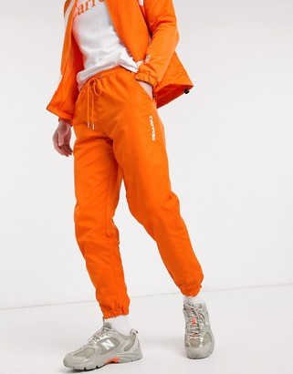 Carrots Wordmark nylon track pants in orange