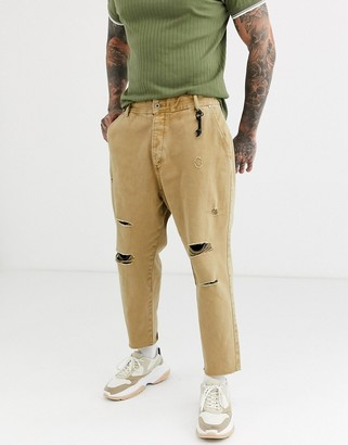 Bershka carrot loose fit jeans with rips in camel-Beige
