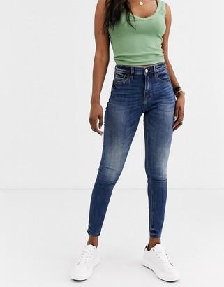 Stradivarius high waist skinny jean in mid blue