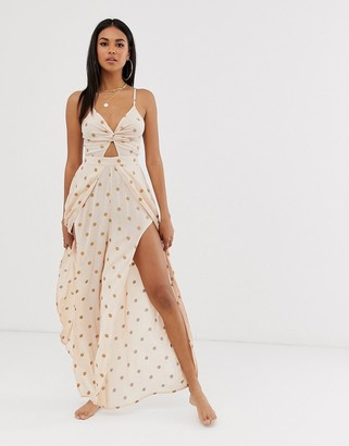 ASOS DESIGN tie back beach jumpsuit with wrap legs in metallic polka dot