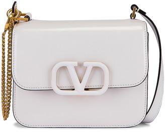 Valentino Small VSling Shoulder Bag in Bianco Ottico | FWRD