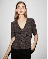 Express dotted v-neck tie back puff sleeve blouse