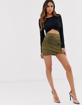 ASOS DESIGN wrap front mini skirt with gold bar trim