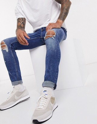 Topman skinny jeans with blowout rips in mid wash blue