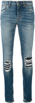Saint Laurent ripped detail jeans - women - Cotton/Spandex/Elastane - 27