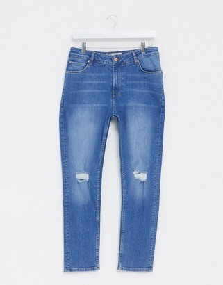 ASOS DESIGN cropped skinny jeans in mid wash with knee rips