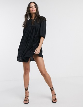 Asos Design DESIGN mini pleated smock dress with puff sleeve in black