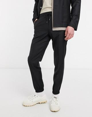 ASOS DESIGN slim soft tailored smart jogger in black 100% wool