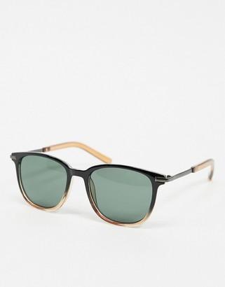 A. J. Morgan AJ Morgan round sunglasses in black with amber fade