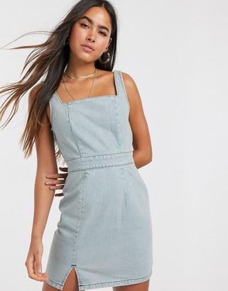 ASOS DESIGN denim mini dress in light wash blue