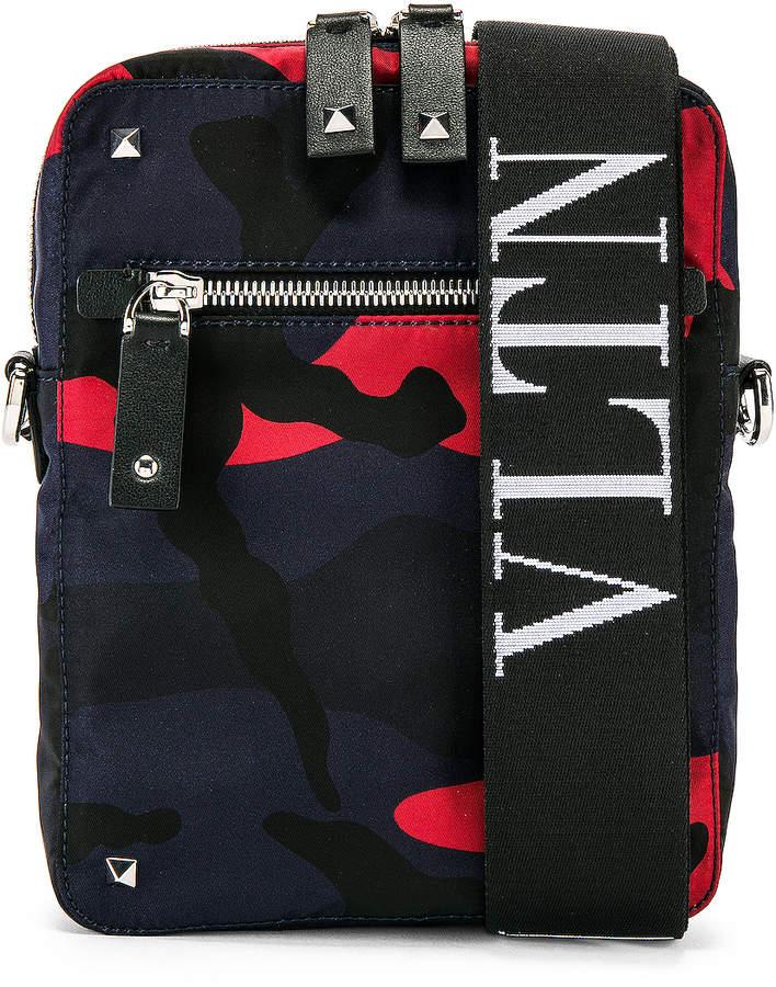 Valentino Messenger Bag in Marine & Red | FWRD