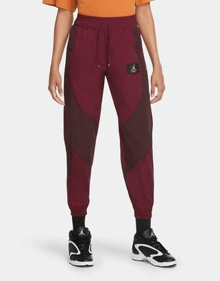 Jordan Nike Statement Essentials woven cuffed sweatpants in burgundy