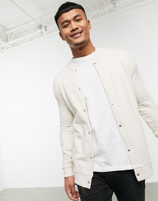 ASOS DESIGN organic jersey muscle bomber jacket in beige with poppers