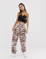 Asos Design DESIGN ovoid pleat front peg pants in tiger print