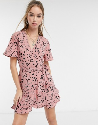 Influence wrap front mini dress in dusky pink heart print