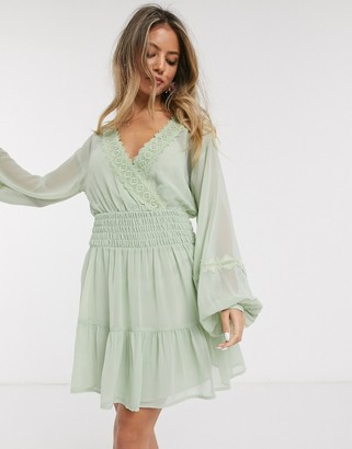 ASOS DESIGN lace insert shirred waist mini skater dress in sage green