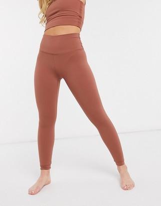 Nike Training Nike Yoga Luxe cropped leggings in red
