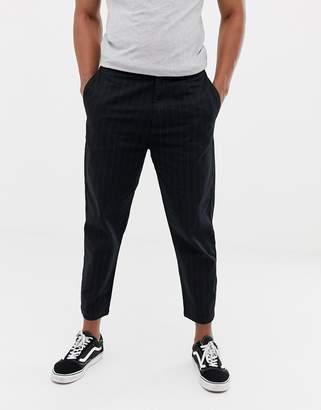 Bershka carrot fit trousers with pin stripe in black