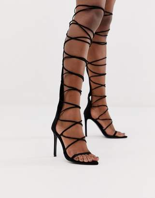 Asos Design DESIGN Harsh knee high gladiator heeled sandals in black