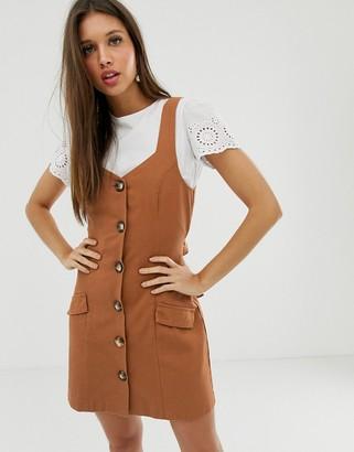 Asos Design DESIGN denim button pinafore mini dress in rust-Red