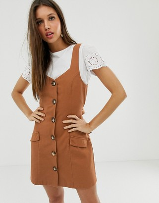 ASOS DESIGN denim button pinafore mini dress in rust