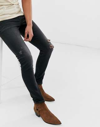 Asos Design DESIGN 12.5oz super skinny jeans in washed black with abrasions