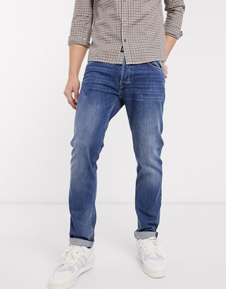 Replay Donny slim tapered fit jeans in mid wash
