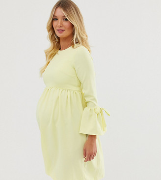 Queen Bee Maternity skater dress with fluted sleeve in pastel yellow