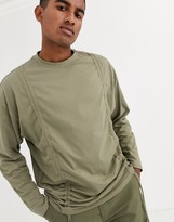 Asos Design DESIGN organic oversized longline long sleeve t-shirt with ruching in khaki