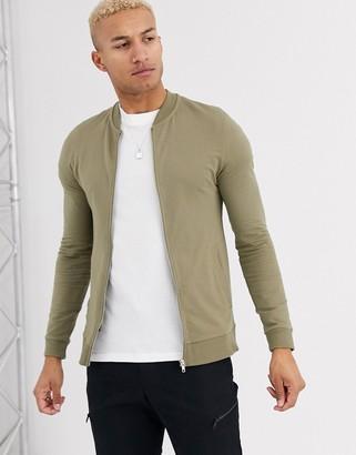Asos Design DESIGN muscle jersey bomber jacket in light khaki-Green