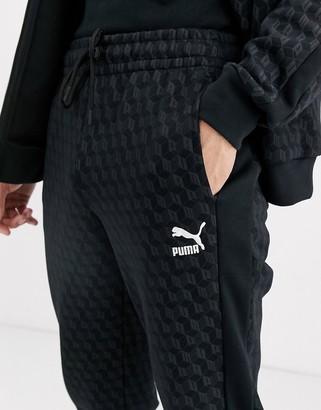 Puma repeat logo sweatpants in black