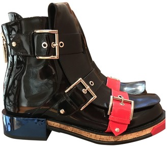 Alexander McQueen Black Patent leather Ankle boots