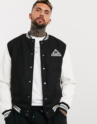 ASOS DESIGN varsity bomber jacket with faux leather sleeves in black and white